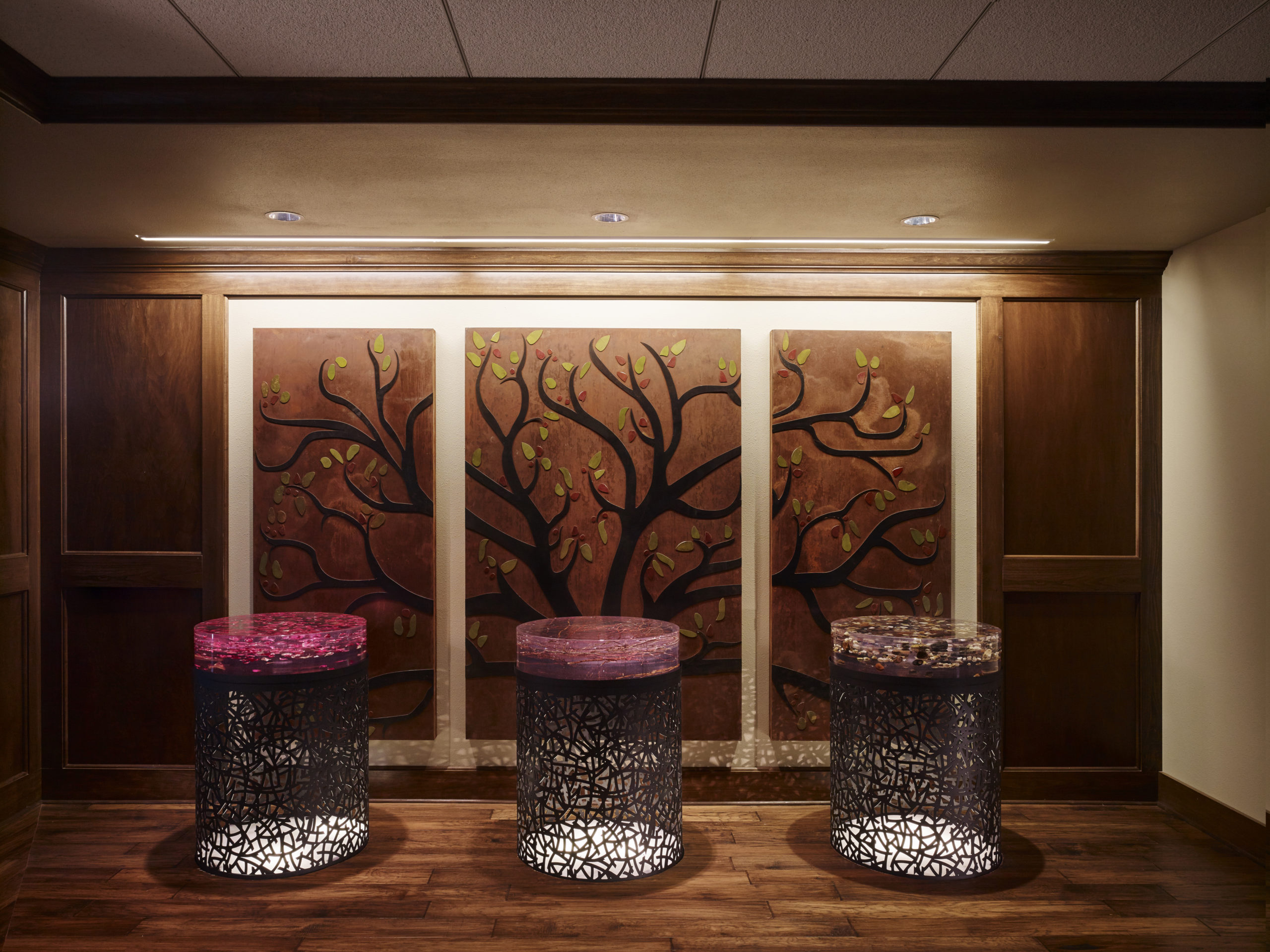 Lobby Pedestals with elements from nature (rose petals, twigs, lack pebbles) embedded into resin. The shaft with rose petals directs natural light to statue of Mary in Basement Chapel