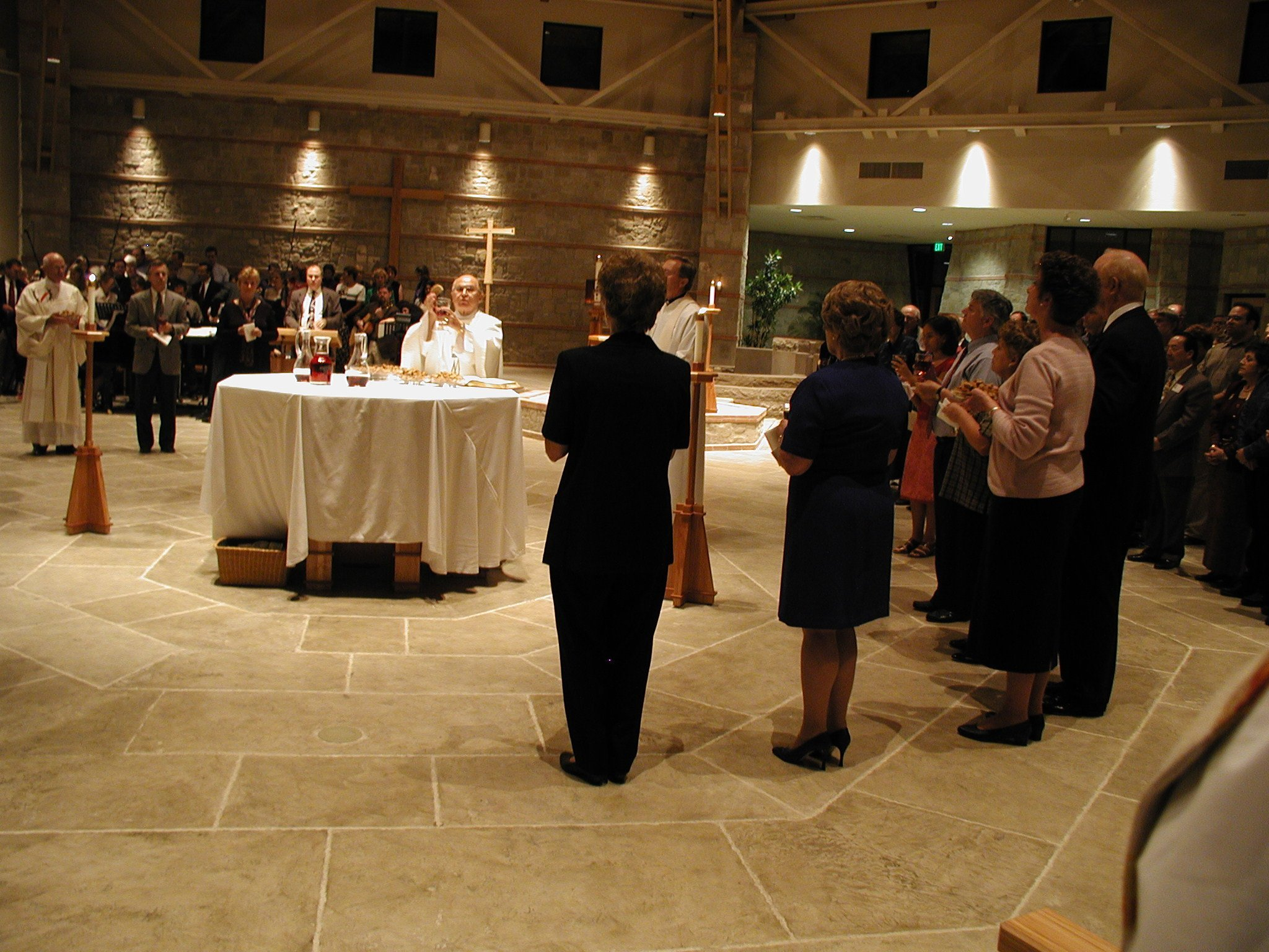 Eucharistic Ministers gathered around the Altar