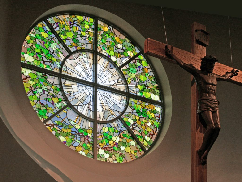 Contemporary rose window depicts the Christian Trinity