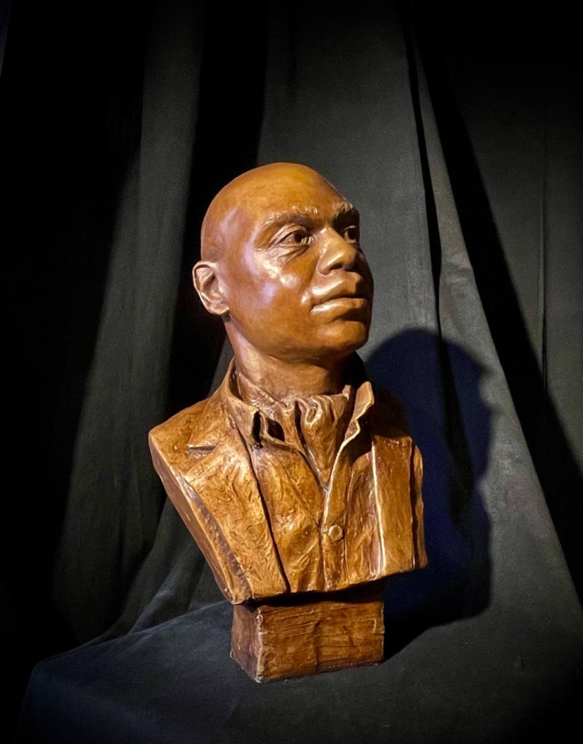 Portrait of Moe Bracy, Life-size resin with faux bronze finish